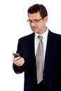 Adult businessman with smartphone mobilephone isolated on white Royalty Free Stock Photography