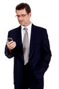 Adult businessman with smartphone mobilephone isolated on white Stock Images