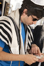 Adult caucasian jewish man wearing praying shawl yarmulke phylacteries being helped rabbi praying man Stock Photos