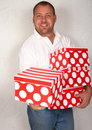 Adult Caucasian man with Christmas boxes Royalty Free Stock Images