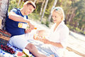 Adult couple having picnic at the beach Royalty Free Stock Photo