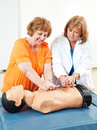 Adult ed learning cpr doctor teaches education student how to perform Stock Photos