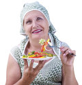 Adult female eating fresh vegetable salad Stock Photography