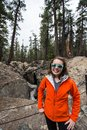 Adult female stands next to the earthquake fault line in Mammoth lakes to show scale of the California quake damage