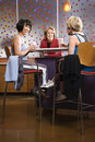 Adult females sitting at table in health club. Royalty Free Stock Photos