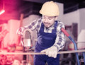 Adult guy is using power jigsaw for construction work Royalty Free Stock Photo