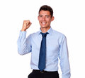 Adult handsome businessman celebrating his victory a portrait on an on blue shirt and tie while smiling and looking to people on Royalty Free Stock Photos