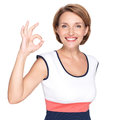 Adult happy woman with ok gesture portrait of a beautiful over white background Royalty Free Stock Photos