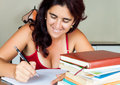 Adult hispanic woman studying at home Royalty Free Stock Image