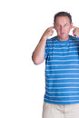 Adult man with fingers in his ears white middle aged Stock Image