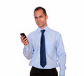 Adult man looking at you calling on cellphone portrait of an while is over white background Royalty Free Stock Images