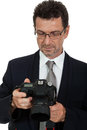 Adult man photographer with digital camera dslr isolated on white Royalty Free Stock Photo