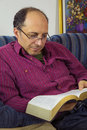 Adult man reading a bible Royalty Free Stock Photo