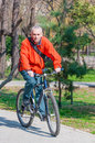 Adult man riding a bike in park sunny day concept of healthy living active people Royalty Free Stock Photo