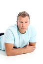 Adult man with a shirt posing in studio grown Royalty Free Stock Photography