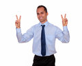 Adult man smiling and showing you victory sign portrait of an against white background Stock Images