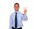 Adult man smiling and showing you victory sign portrait of an on isolated background Stock Photography