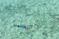 Adult man snorkeling in a tropical sea thailand Royalty Free Stock Images