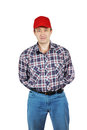 Adult man wearing jeans and a plaid shirt with red cap isolated on white background Stock Image