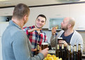 Adult men relaxing with beer Royalty Free Stock Photo