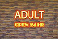 Adult neon sign with hr open signage Stock Photo