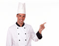Adult professional chef pointing to his left Stock Photo