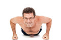 Adult smiling man doing workout pushups isolated fitness on white Stock Photography
