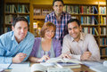 Adult students studying together in the library portrait of four mature Stock Images