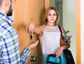 Adult watching how spouse moving out with baggage Royalty Free Stock Photo