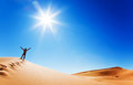 Adult white man standing on a sand dune Royalty Free Stock Photo