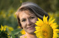 Adult woman with bob cut portrait of caucasian hair in sunflowers Stock Photo