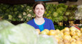 Adult woman buys fruits at market Royalty Free Stock Photography