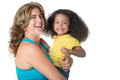 Adult woman carrying a cute afroamerican girl Royalty Free Stock Photo