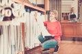Adult woman choosing interesting fabric