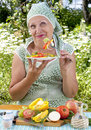 The adult woman eats vegetables salad Royalty Free Stock Photos