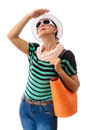 Adult woman looking at sun summer hat dressed with accessories and orange bag protecting eyes with hand sunglasses straw white Royalty Free Stock Photo