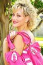 Adult woman with pink purse Stock Photo