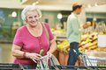 Adult woman shopping vegetables during at fruit or vegetable supermarket store shop Royalty Free Stock Images