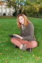 Adult woman with tablet pc outdoors portrait of beautiful Royalty Free Stock Photo