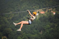 Adult woman on zip line Royalty Free Stock Photo