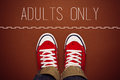 Adults only concept person standing at dividing line young teenage in red sneakers of restricted area Royalty Free Stock Images