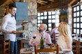 Adults having dinner and waiter portrait of people respectful Stock Photos