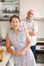 Adults people at kitchen woman and men standing in Stock Photo