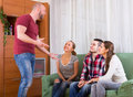 Adults playing charades happy in hall and laughing Royalty Free Stock Image