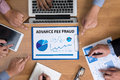 Advance fee fraud business team hands at work with financial reports and a laptop top view Royalty Free Stock Image