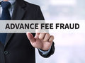 Advance fee fraud businessman touching a touch screen on blurred city background Stock Images