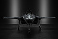 Advanced F35 secret jet in an undisclosed location with silhouette lighting.