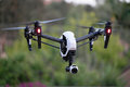Advanced flying quadcopter drone dji inspire s newest k in flight mode with camera pointed at viewer Stock Photo