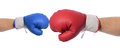 Advantage big red v blue boxing gloves with big red having the on white background Stock Photography