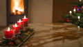Advent candles with Christmas tree and burning chimney fire Royalty Free Stock Photo